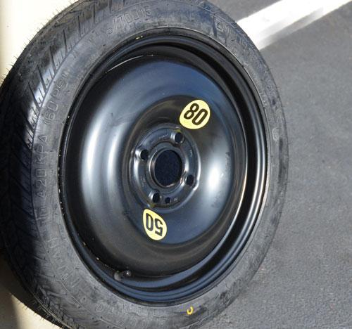 Micro Space Saver Spare Tire + Wheel: 4 Lug